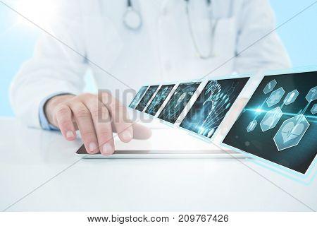 Doctor using digital 3D tablet against white background against blue vignette background