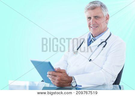 Portrait of confident male doctor using digital 3D tablet against blue vignette background