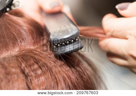 Barber work in a beauty salon . photo in the studio