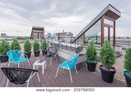 Rooftop Terrace With Modern Chairs