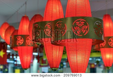 Chinese Vietnamese red lanterns hung on a traditional Asian holiday