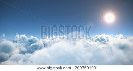 Scenic view of sun over cloudscape against blue sky during sunny day