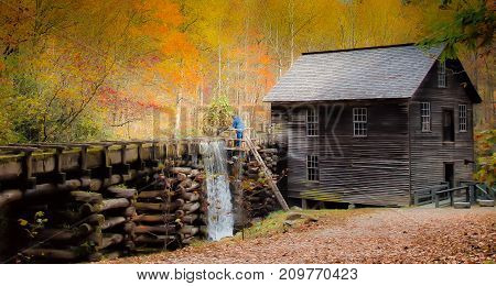 Historic gristmill with fall leaves all around