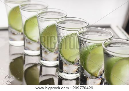 Vodka, Gin, Tequila With Lime. Cocktail.