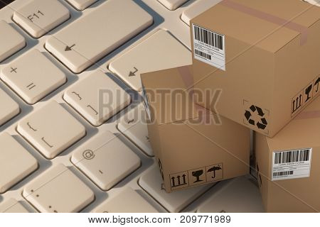 High angle view of cardboard 3D boxes against finger pressing enter key