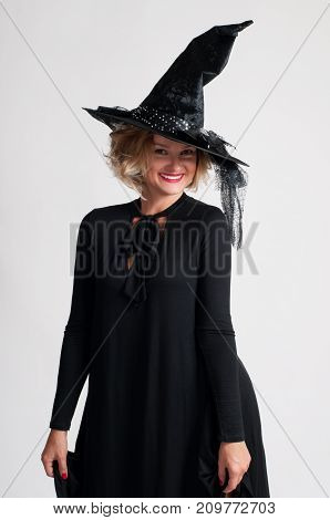 Happy Woman In Witch Halloween Costume With Hat