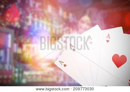 Digital 3D composite image playing cards against pretty bartender pouring tequila into glasses