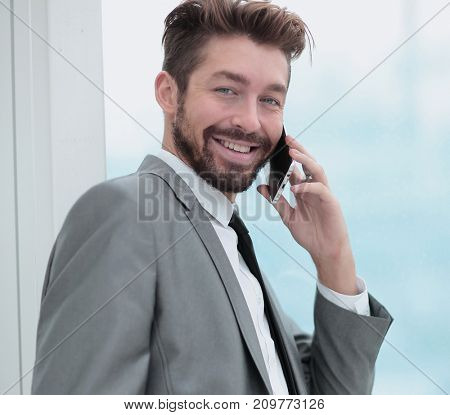 Handsome Business man in an office using smartphone