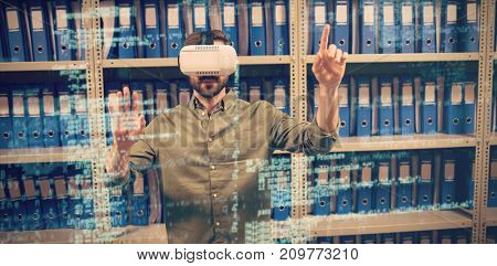 Image of data against businessman experiencing 3D virtual reality in file storage room