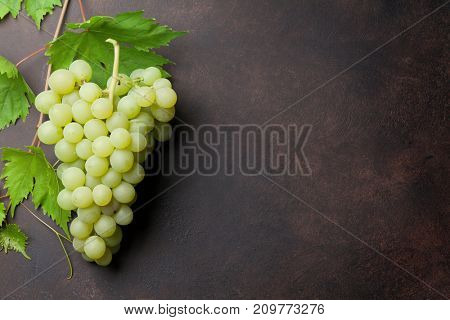 White grapes on stone table. Top view with space for your text