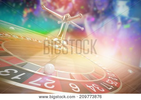 Happy friends having fun in limousine against 3d image of ball on wooden roulette wheel