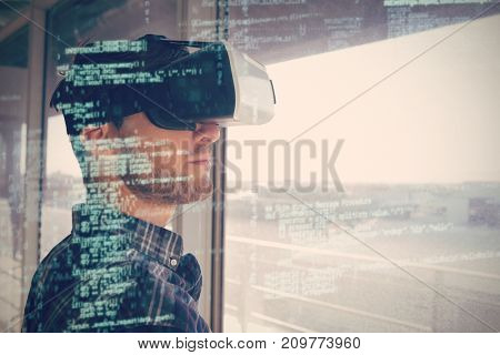 Close up of young businessman wearing vr 3D headset by window in office