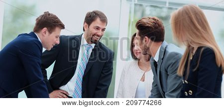 Business people working and discussing together at meeting in of