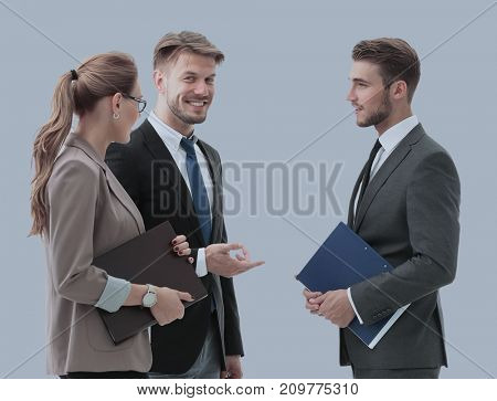 Happy business people in formalwear discussing a new project.