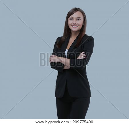 Successful business woman with arms crossed - isolated over blue background