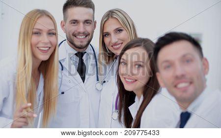 Smiling Team Of Doctors  At Hospital Making Selfie
