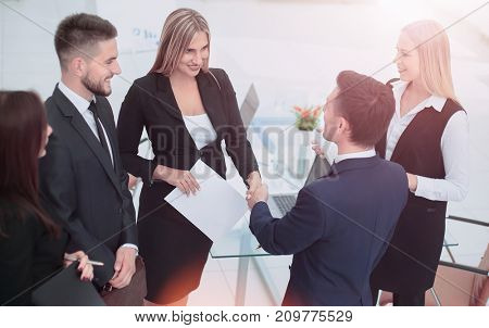 Businesss and office concept - two businessmen shaking hands in