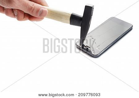 Male Hand Breaks A Smartphone With A Hammer Against A White Background