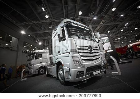 MOSCOW, SEP, 5, 2017: Silver trucks Mercedes-Benz Actros exhibits on Commercial Transport Exhibition ComTrans-2017. Commercial Mercedes trucks. Automobile industry. Commercial transportation vehicles