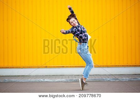 Smile and happy young woman hip hop dancer with grunge wall background texture