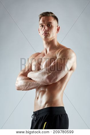 sport, bodybuilding, fitness and people concept - young man or bodybuilder with bare torso