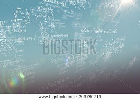Mathematical complicated formulas against blue sky