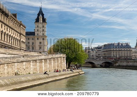 The picturesque embankments of the Seine in Paris, France. Buildings and trees