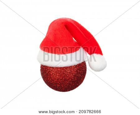 The Santa hat on a red Christmas ball isolated on a white background