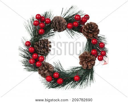 Delicate Christmas wreath with pine cones and red berries isolated on a white background