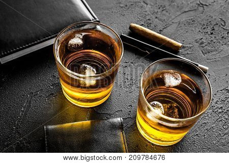 whiskey cocktails, cigar, wallet and notebook for men meeting on black pub table background