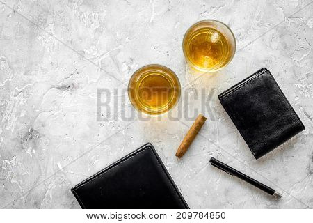 whiskey cocktails, cigar, wallet and notebook for men meeting on stone pub table background top view mock up