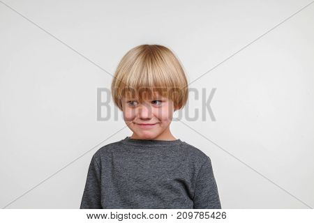 Cool horisontal portrait of handsome happy child, photo on grey background
