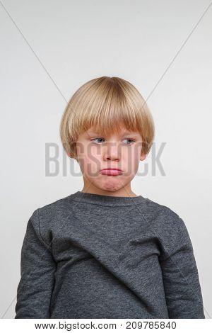 New cool vertical emotional portrait of caucasian boy