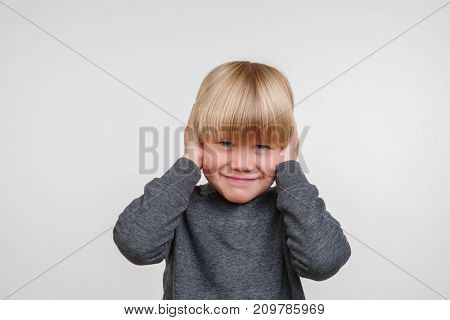 Cute horisontal photo of handsome happy child