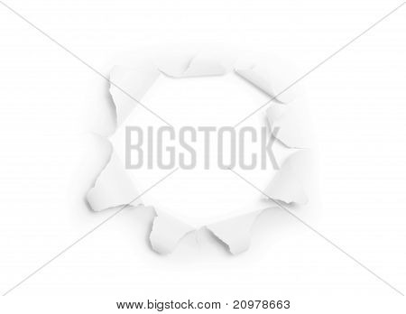 The sheet of torn paper with round hole (isolated)