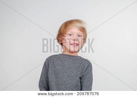 New horisontal emotional portrait of caucasian boy. Handsome happy child, isolated on white background