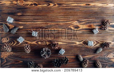 pine cones on a brown woody background