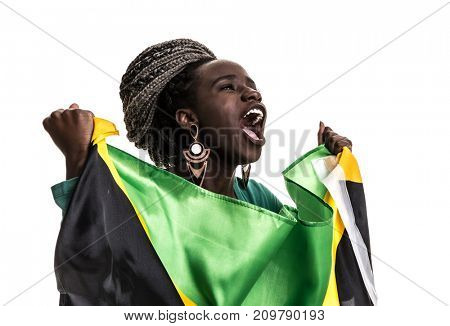 Jamaican fan celebrating with the national flag
