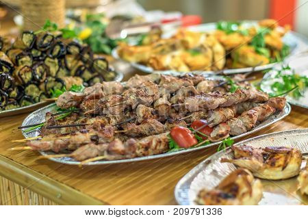 barbecue and other dishes in the restaurant of oriental food