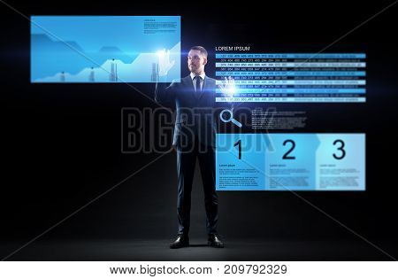 business, people, augmented reality and finances concept - businessman working with stock charts on virtual screens over black background