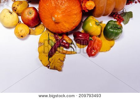a bunch of various fruits and vegetables scattered on the table