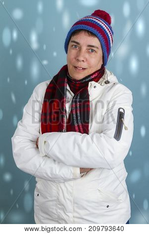 Woman in winter clothes with arms crossed. Shot in Studio.