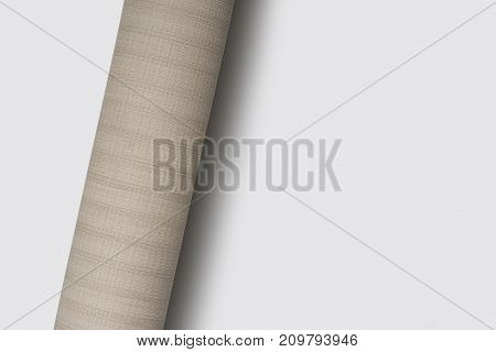 rolled light brown textured surface in light grey background with shadow