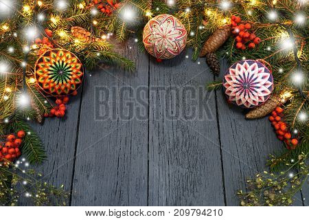 New Year's wreath from a green Christmas tree with cones on a wooden background