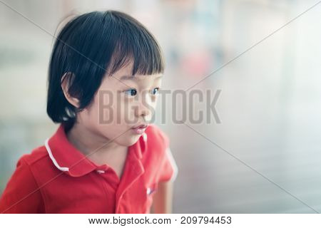 Asian little girl pucker the mouth making funny face