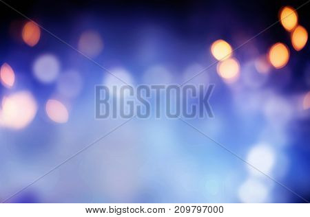 Winter background with copy space for Christmas seasonal cards with blurred city lights outdoors at night. 3d rendering