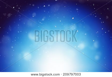 Magical winter blue background with blurred white lights and snowflakes floating against sky at night