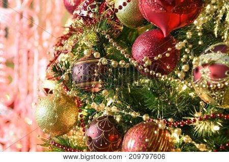 Christmas tree with ornaments and lights in elegant home