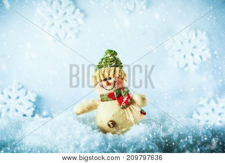 Smiling Snowman in the snow