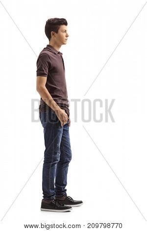 Full length profile shot of a teenage boy waiting in line isolated on white background